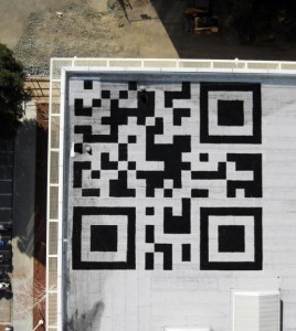 Use your iPhone QR Code reader from space:  it's scannable from there.